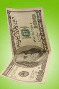 Money%20%24100%20Dollar%20Bill%20on%20Green%20Background.jpg