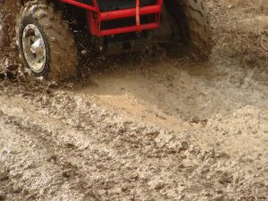 atv%20all%20terrain%20vehicle%20red%20in%20mud.jpg