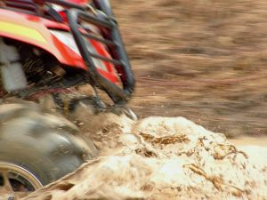 atv%20all%20terrain%20vehilce%20four%20wheeler%20front%20end%20in%20mud.jpg