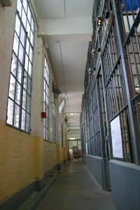 criminal%20jail%20hallway%20with%20white%20and%20yellow%20walls.jpg