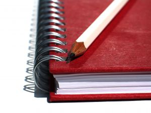 education%20school%20day%20care%20red%20notebook%20with%20white%20pencil.jpg
