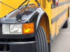 education%20school%20day%20care%20yellow%20school%20bus%20view%20of%20driver%20front%20light.jpg