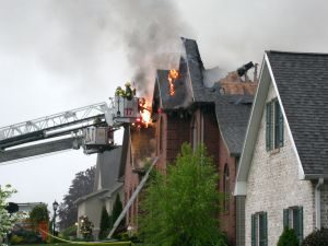 fires%20burns%20house%20fire%20with%20fire%20rescue%20ladder.jpg