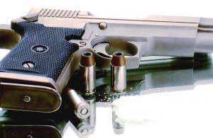 gun%20handgun%20with%20two%20bullets.jpg