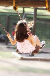 playground%20child%20on%20swing%20girl%20day%20time.jpg