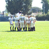 sports%20-%20huddle%20w.%20coach.jpg