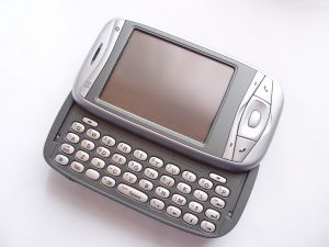 technology%20mobile%20cell%20phone%20with%20key%20pad%20silver.jpg
